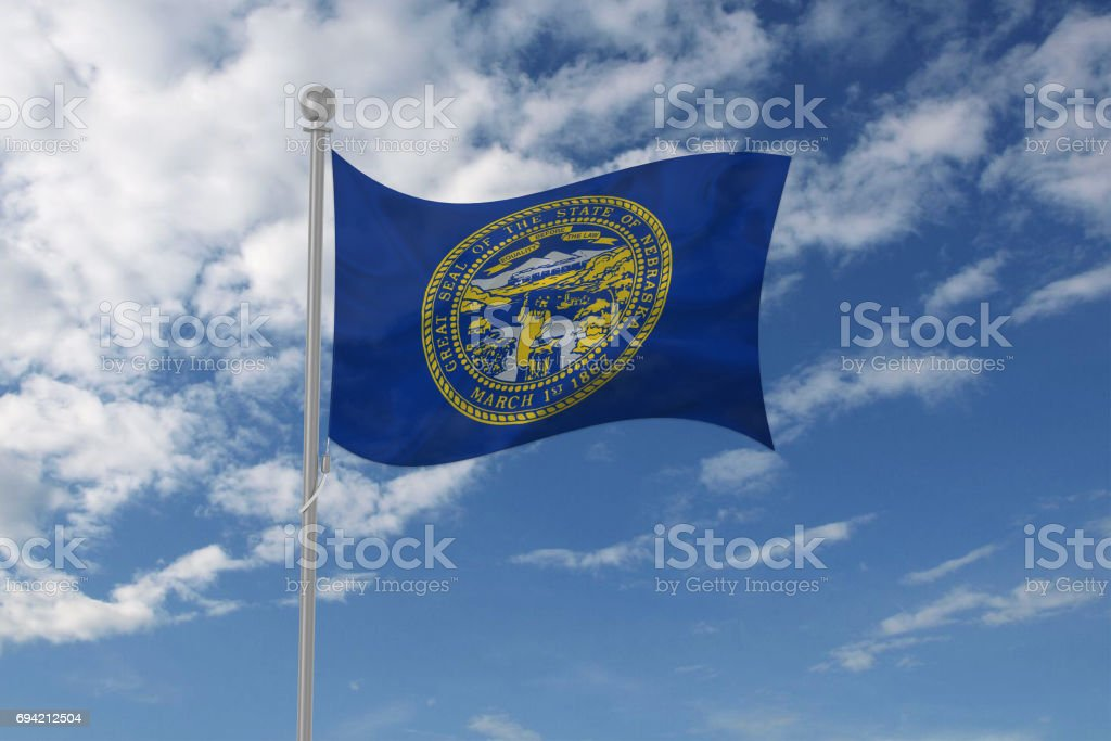 Nebraska flag waving in the sky stock photo