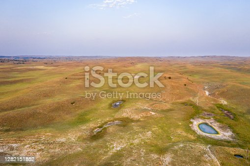 landscape of Nebraska Sandhills, early morning aerial view at Nebraska National Forest with cattle water holes