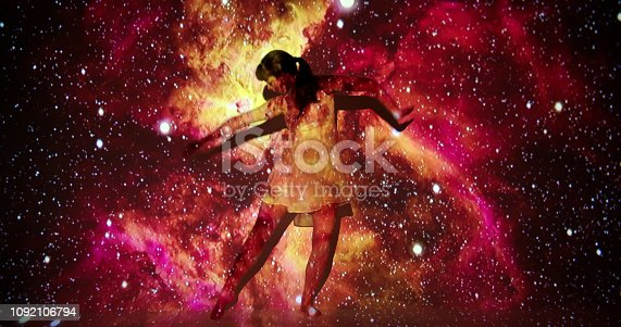 Nebula projection upon a female dancer.
