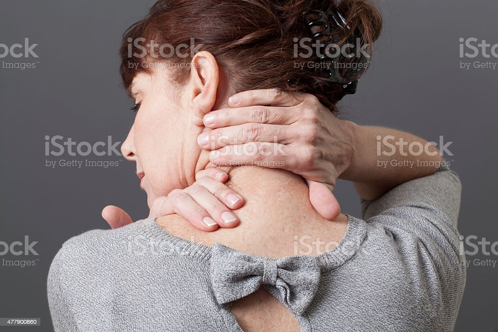neck and shoulder gestures for releasing tension stock photo