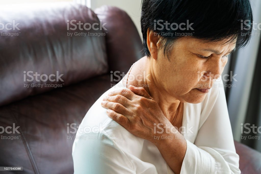 neck and shoulder pain, old woman suffering from neck and shoulder injury, health problem concept royalty-free stock photo