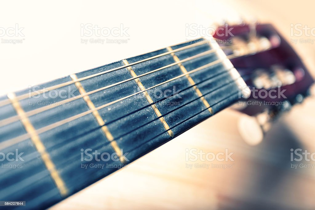 Neck of a guitar with strings and head. stock photo