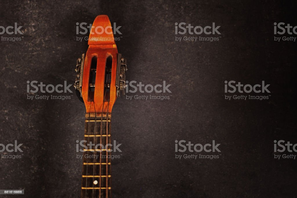 neck of a stringed instrument mandolin on a dark background with copy space for your text stock photo