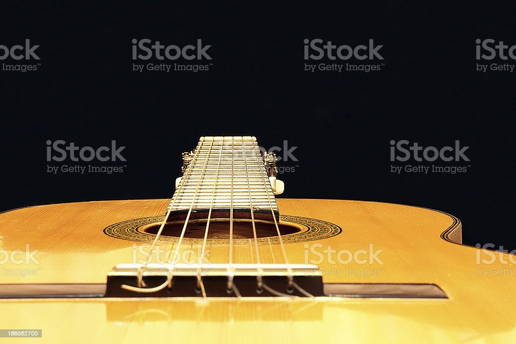 Neck of the guitar in perspective. royalty-free stock photo