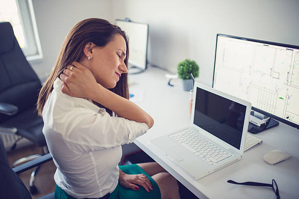 Neck pain at work Businesswoman having pain in her neck,Neck pain at work human neck stock pictures, royalty-free photos & images
