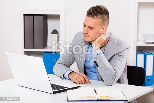 istock Neck pain at work 628332804