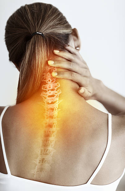 Neck pain can be debilitating stock photo