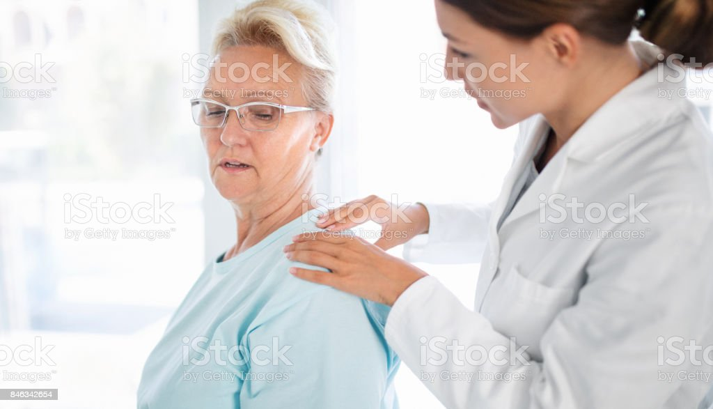Neck pain therapy. stock photo