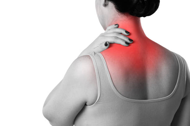 Neck pain, woman with backache isolated on white background Neck pain, woman with backache isolated on white background, studio shot with red dot human neck stock pictures, royalty-free photos & images