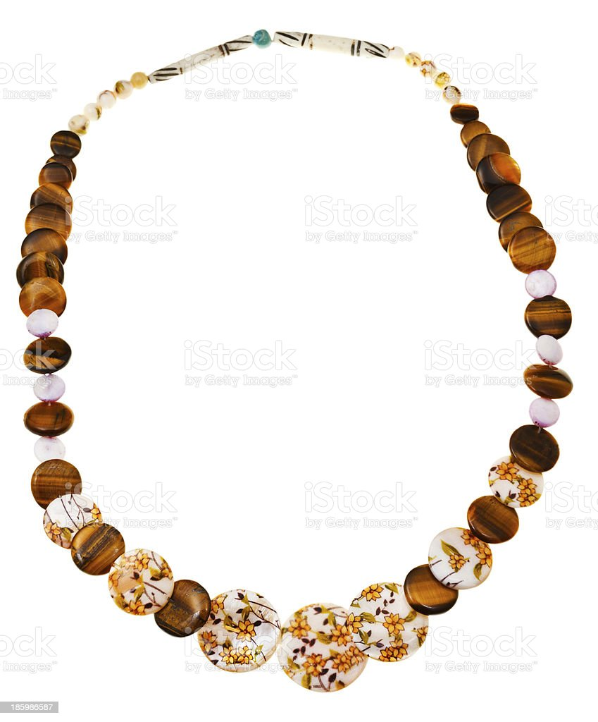 necklace from nacre, tigers eye, carved bone royalty-free stock photo