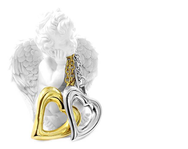 halskette mit herz und angel - schmuck engel stock-fotos und bilder