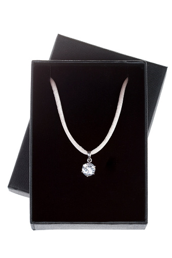 Necklace in an isolated black gift box.