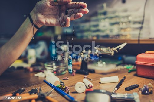 991427116 istock photo Necklace in making 1006284188