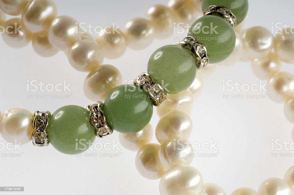 Necklace made of pearl, green onix and artificial diamonds royalty-free stock photo