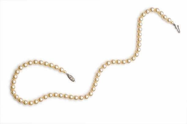 Necklace made with small pearls over a white background stock photo