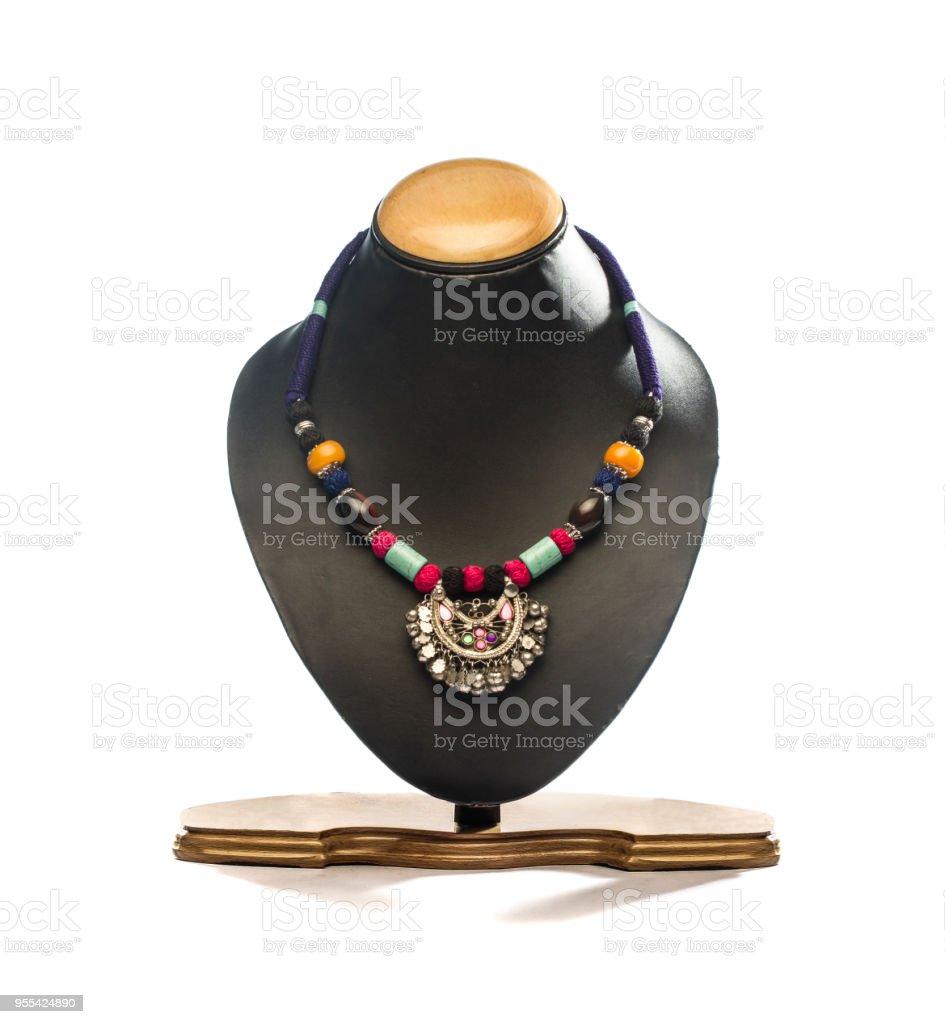 necklace on black mannequin isolated on white background - Zbiór zdjęć royalty-free (Akcesorium osobiste)