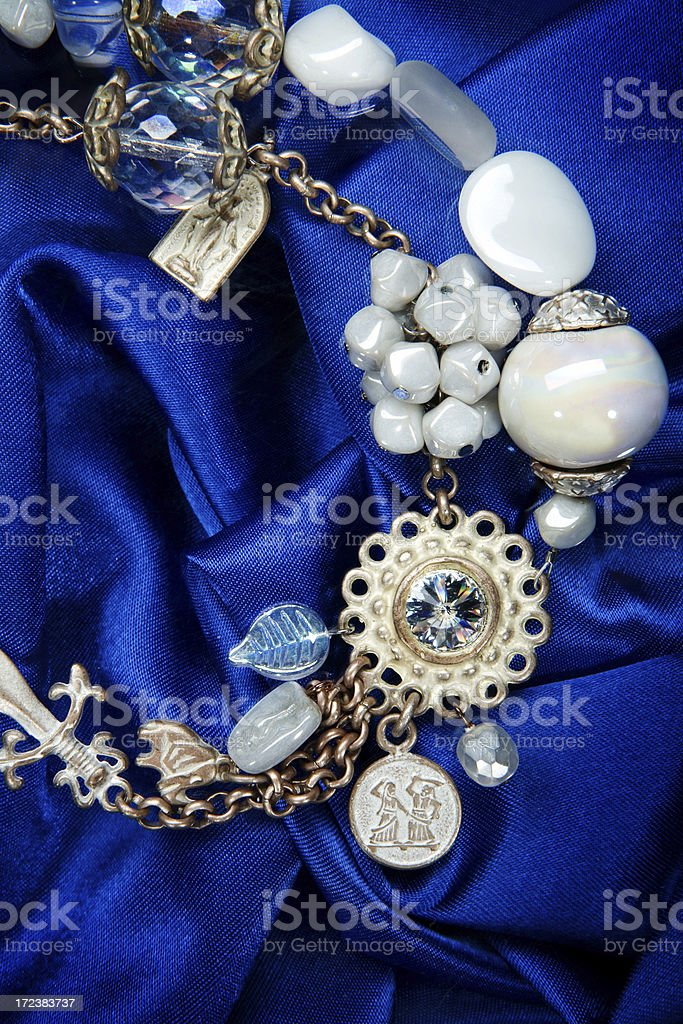 necklace on blue textil royalty-free stock photo
