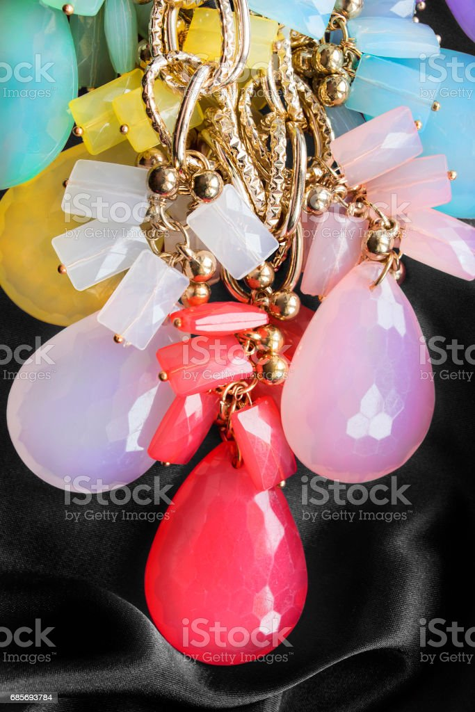 Necklace on silk royalty-free stock photo