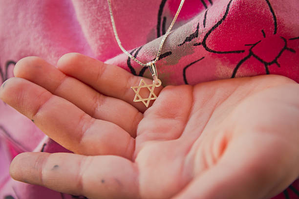 Necklace with the Star of David on a girl's hand stock photo