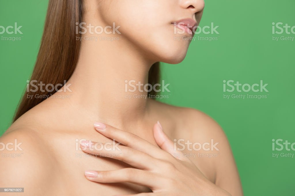 Neckline of young woman. Skin care concept. stock photo