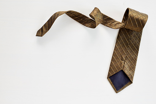 Necktie on white wooden background , Father 's Day concept