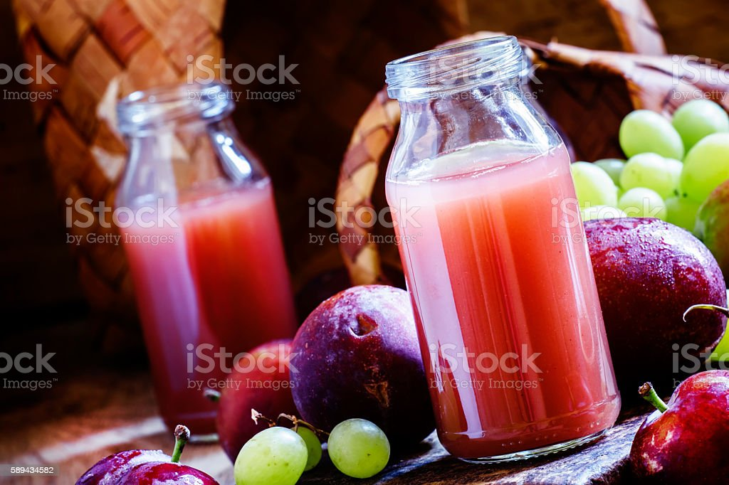 nectar of sweet plums and grapes stock photo