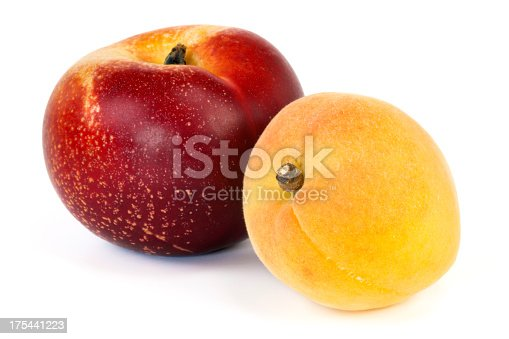 Nectarine and apricot on white background. Selective focus, shallow DOF.