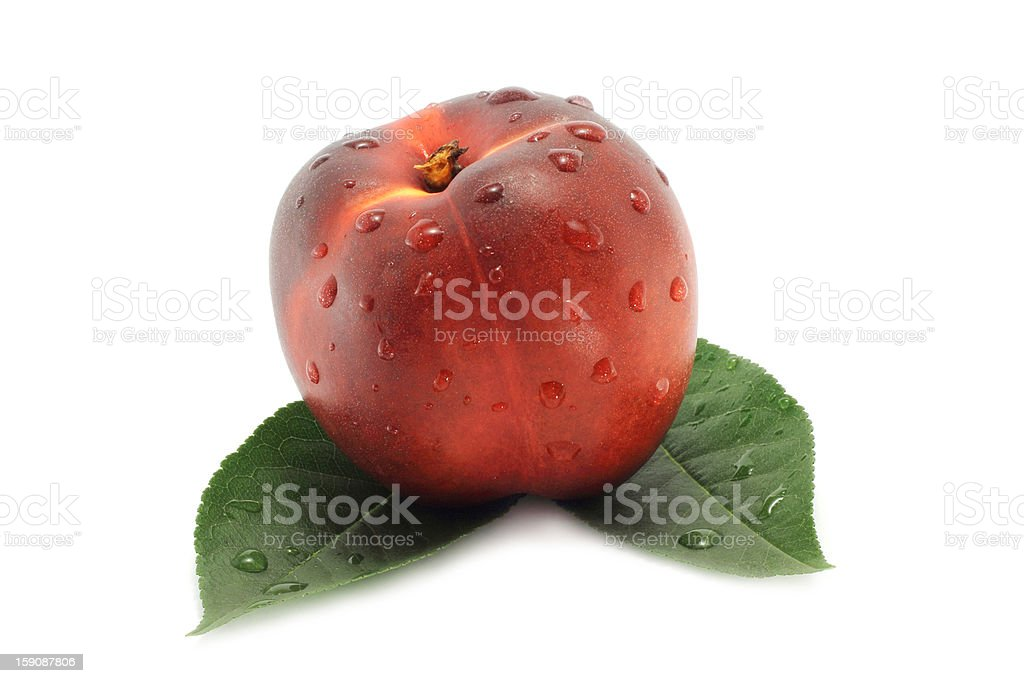 Nectarine and green leaves royalty-free stock photo