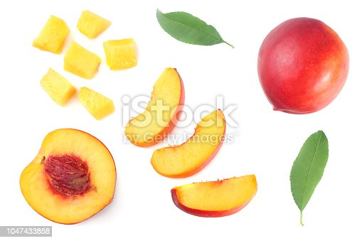Nectarine with green leaf and slices isolated on white background. top view