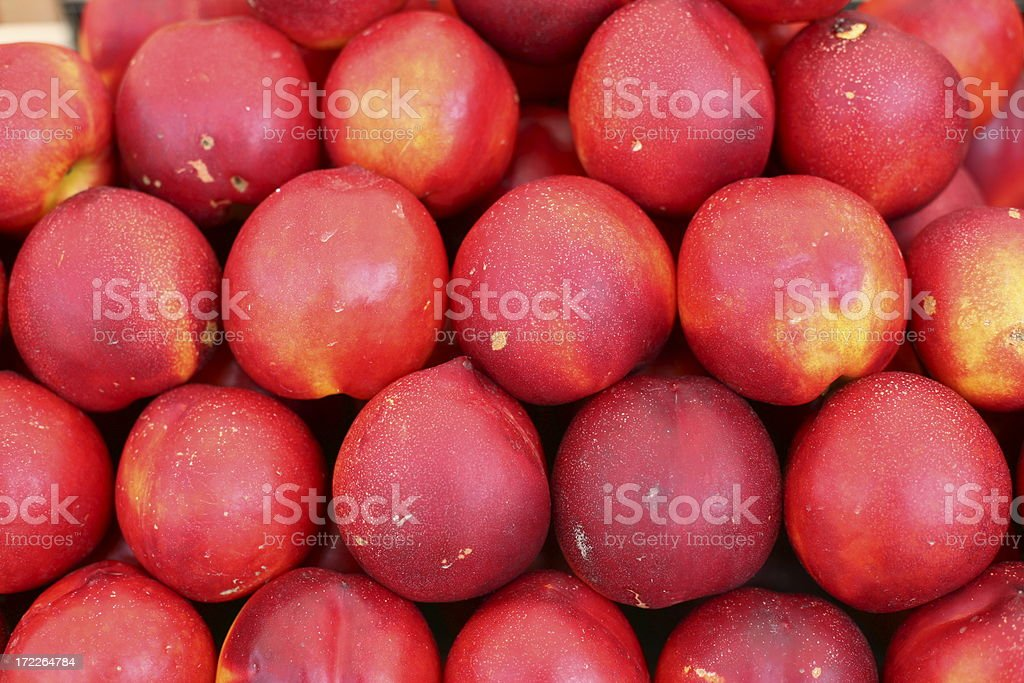 Nectarines at a farmers market royalty-free stock photo
