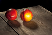 ripe peaches on rustic wood table
