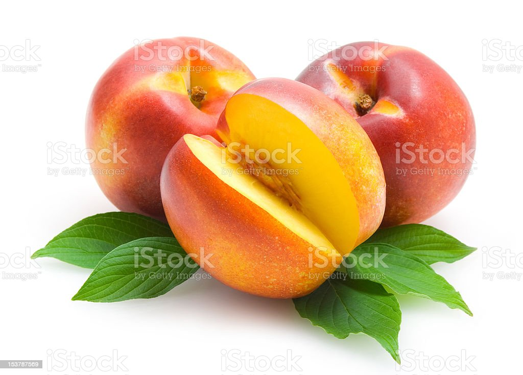 nectarines with leaves stock photo