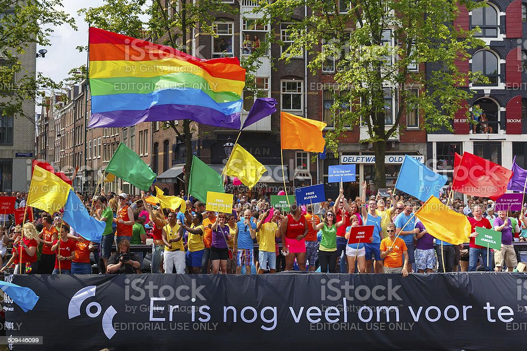 COC Nederland boat at the Amsterdam Canal Parade 2014 royalty-free stock photo