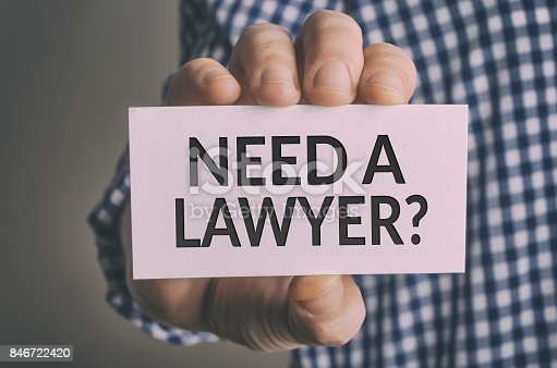 Need a lawyer? card in hand. Legal support and justice concept.
