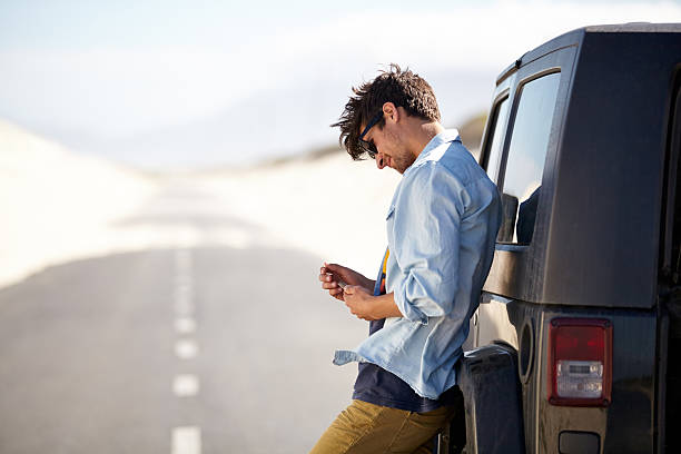 I need a little help out here A young man phoning for roadside assistancehttp://195.154.178.81/DATA/istock_collage/0/shoots/780937.jpg leaning stock pictures, royalty-free photos & images