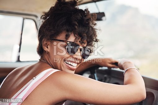 Cropped shot of a beautiful young woman enjoying herself while out on a road trip