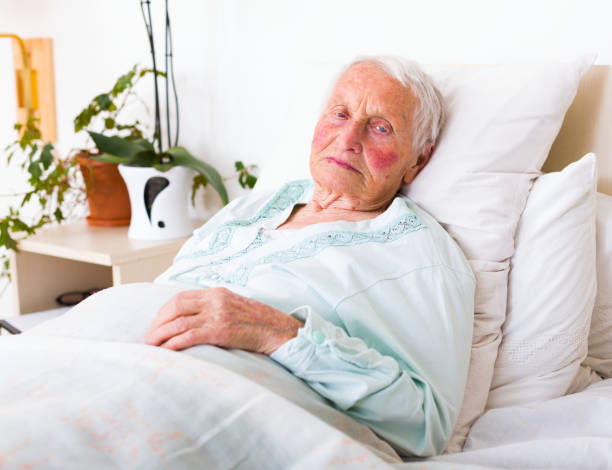 Best Cancer Woman Lying In Hospital Bed Stock Photos