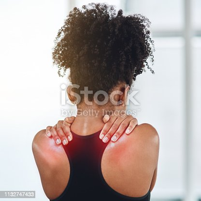Rearview shot of a young woman suffering from back pain