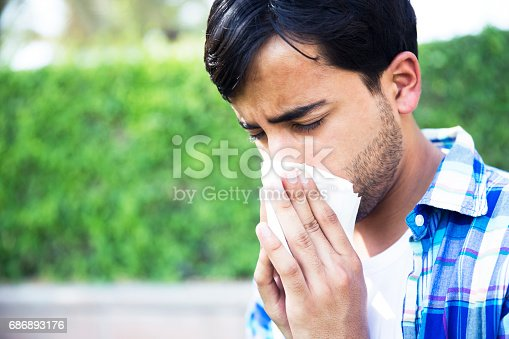629307146istockphoto I need to clear my nose quick and go back home before I sneeze again 686893176