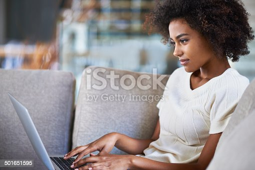 Shot of a young woman using a laptop while relaxing at homehttp://195.154.178.81/DATA/i_collage/pi/shoots/783516.jpg