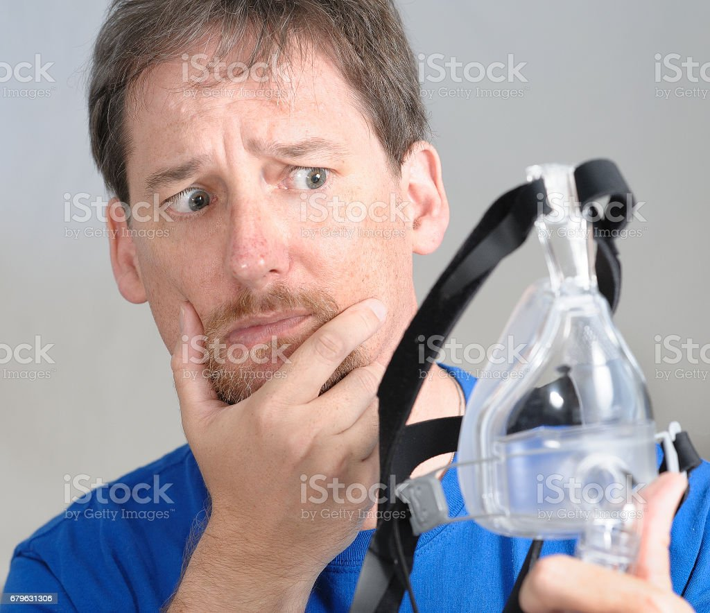 Needing a CPAP mask stock photo