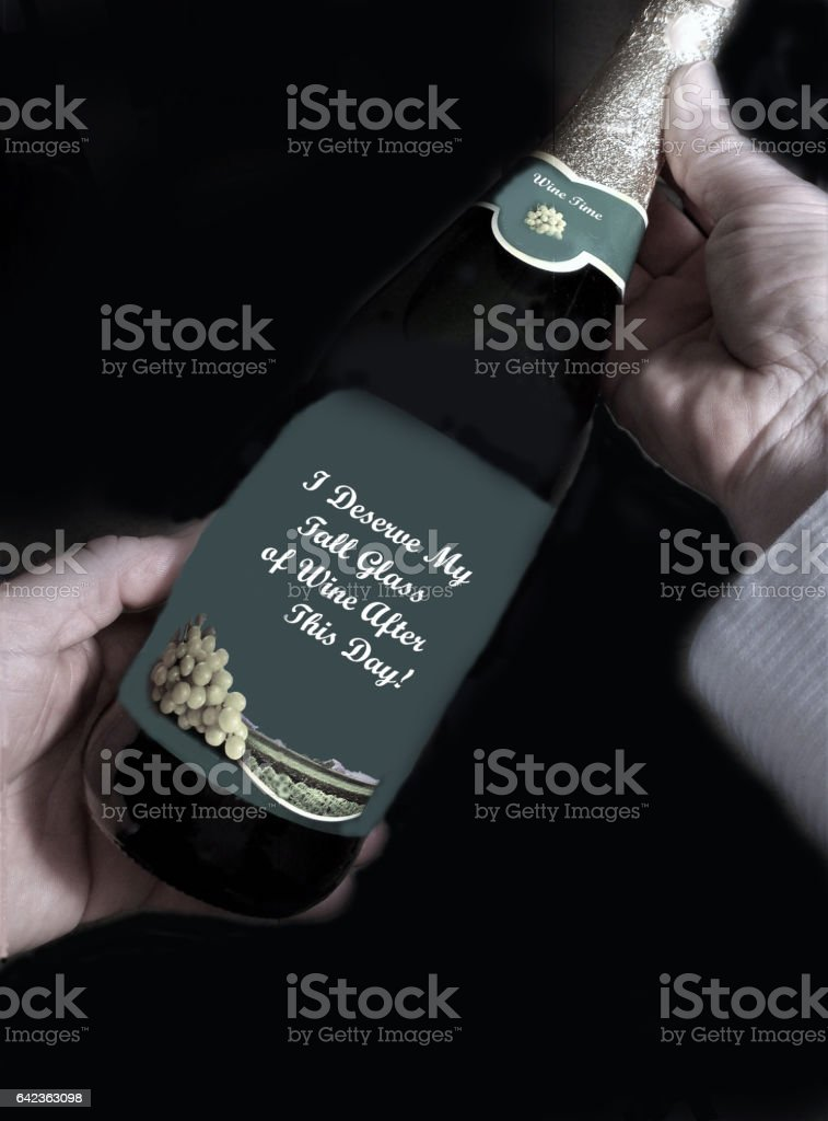 Needing a Glass of Wine - Read the Humorous labeling on the Bottle stock photo