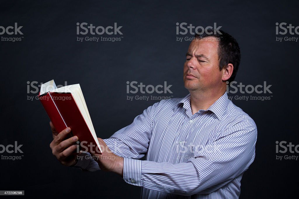 Needing reading glasses stock photo