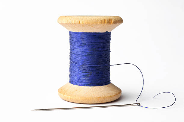 Needle and Blue Line Needle and Blue Line. spool stock pictures, royalty-free photos & images