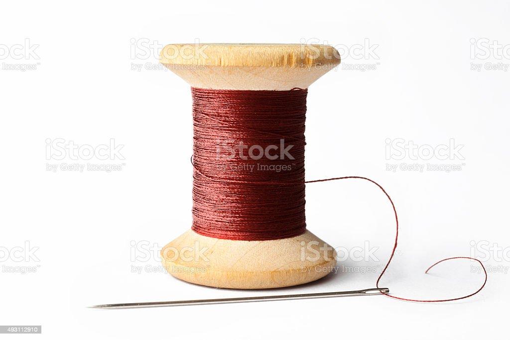 Needle e linha vermelha - foto de acervo