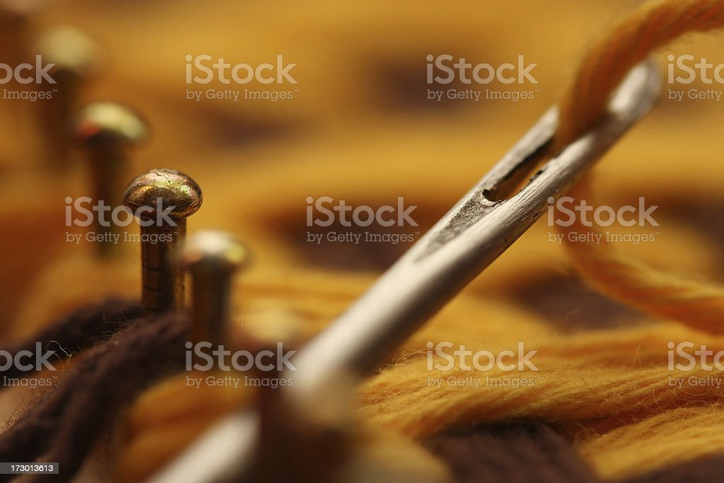 Needle and Textile Being Woven on a Loom stock photo