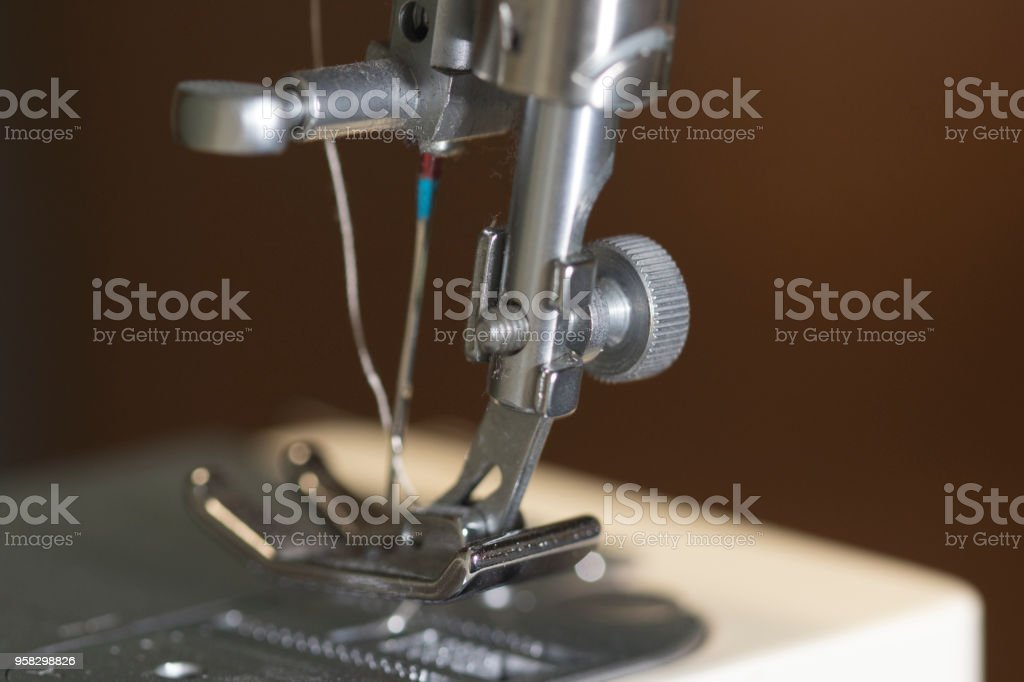needle of a sewing machine stock photo