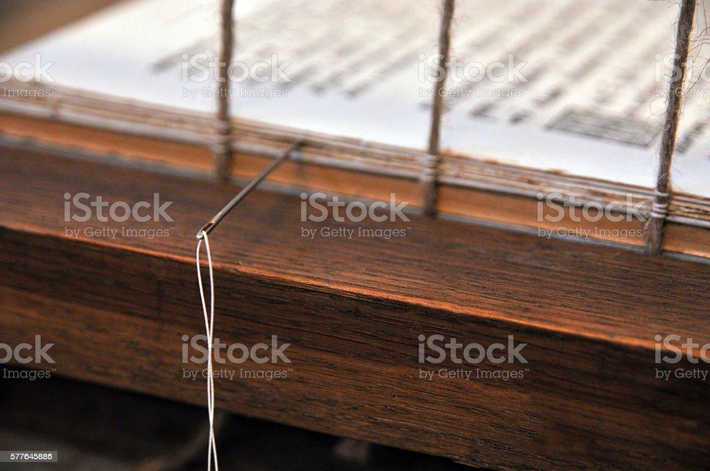 Needle on a binding  book – Foto