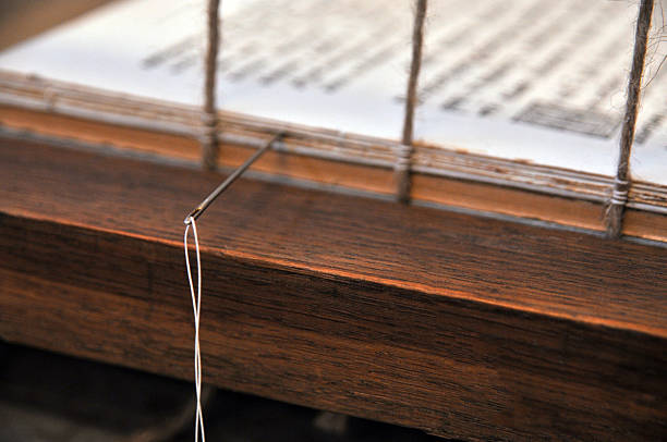 Needle on a binding  book – Foto