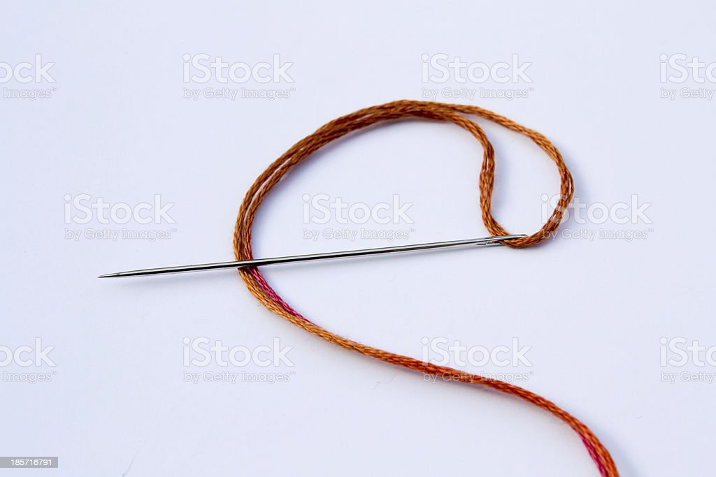 Needle with Orange Thread royalty-free stock photo